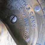 Small clock dial showing maker (John Smith & Sons, Derby) and year of manufacture (1922)