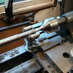 Using a filing rest on the lathe to square the maintaining power arbour