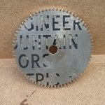 Back of brass wheel, complete with old engraved text.